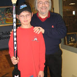Carl Beane and Boy Holding Famous Hockey Player's Stick