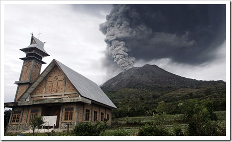 Mount Sinabung volcano spews smoke as seen from Bekerah village in the district of Tanah Karo in Indonesia's North Sumatra province