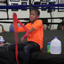 Young Prospect wrapping his hands by Stephen Jones - Sports & Fitness Boxing
