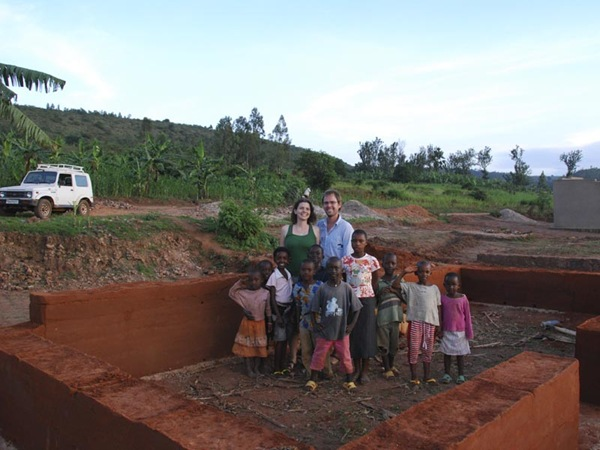 Cheryl, Adam and the local kids inspect the walls