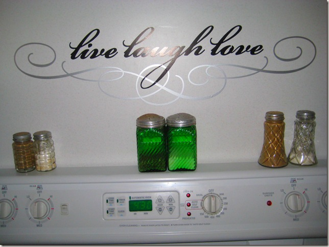 wall behind stove with live laugh love applique