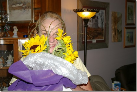 Deanna holding sunflowers