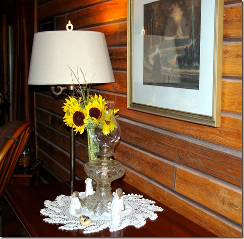 sunflowers with oil lamp