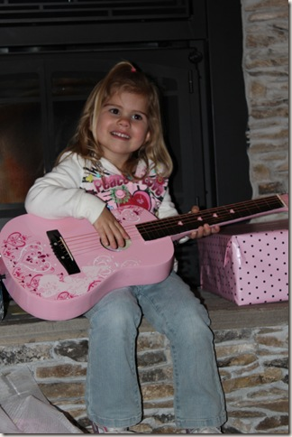 Reagan playing her guitar