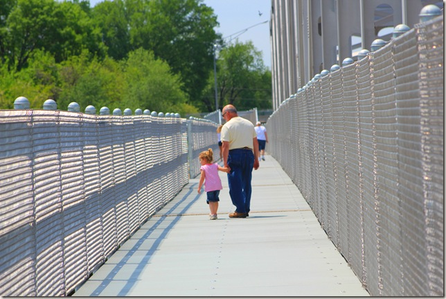 Jim and Reagan walking across the bridge