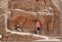 Celine and Tally standing under a Lion. The head is erroded away but you can see where the water once flowed out through his mouth. There are many creative aquaducts in Petra.