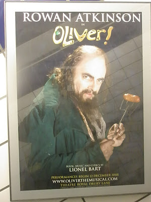 photo showing UK tube advertisement for Oliver! starring Rowan Atkinson as Fagan