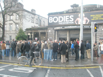 Photo shows exterior of Ambassador Theatre, Dublin with perhaps 50 people queing outside BODIES: the exhbition
