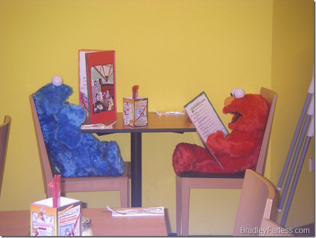 Cookie Monster and Elmo at an N.Y.D.C. Cafe & Restaurant in Singapore.