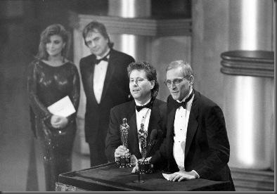 "Alan Menken (music) and Howard Ashman (lyrics) accept their Oscars for Best Original Song for ""Under the Sea,"" from the film THE LITTLE MERMAID (1989). Behind them are presenters Paula Abdul and Dudley Moore. 
