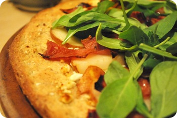 goat cheese, pear, prosciutto, honey, arugula pizza