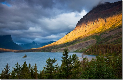 During a rainy, cloudy morning at the Wild Goose scenic overlook on St. Mary Lake in Glacier National Park, Montana, the sun peeped from under the cloud cover long enough to paint a golden-yellow swath across the face of the mountain for maybe 15 minutes before disappearing again. (Photo and caption by Rebecca Latson)