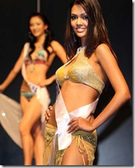 Miss India Esha Gupta (R) poses in swimwear during the Miss International Beauty Pageant press conference in Tokyo, October 03, 2007