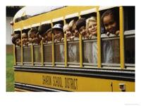 school children looking out school bus