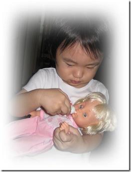 JJ feeding baby