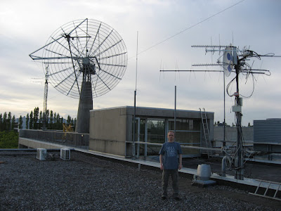 Alexandru Csete OZ9AEC proudly wearing the newly acquired swag from Part Time Scientists in front of the OZ7SAT antennas