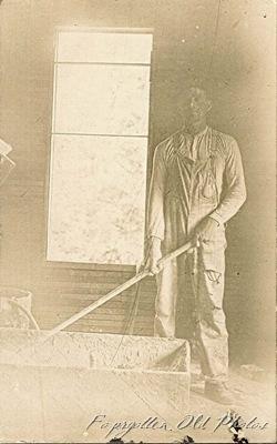 Postcard man mixing plaster