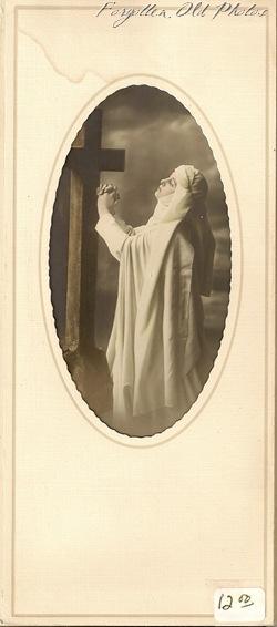 Nun postcard in folder