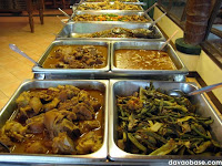 A long table of meat dishes in Nanay Bebeng Restaurant