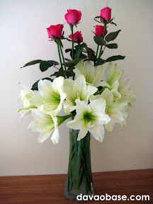 Pink roses and lilies in one vase
