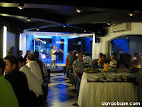 Tap Room showcases a beautiful blue-lit stage (That's fellow blogger Thel Villarta singing).