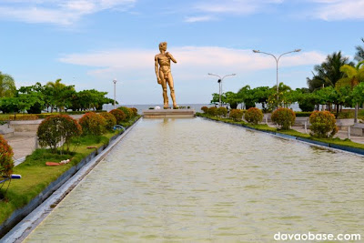 Fish pond in front of the Statue of David at Baywalk along Times Beach shoreline