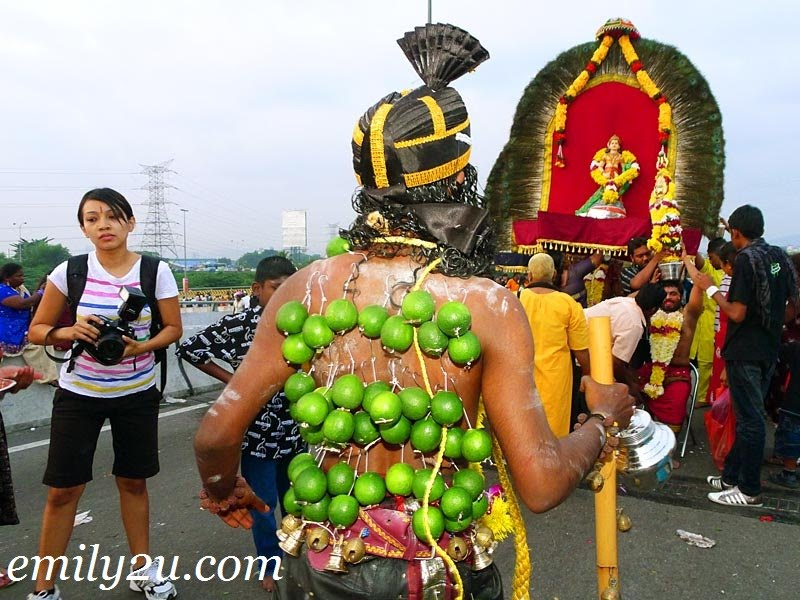Thaipusam devotee with hooked back