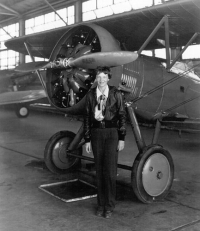 Amelia Earhart on Amelia Earhart With Airplane  In Hangar  July 30  1936