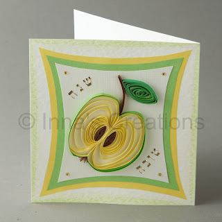 Greeting card with a quilled apple