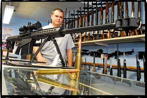 foto: klein 9-13-2007 Just Guns with one of the owners Jimmy with the Barrett 50cal with an effective range of over a mile only takes the MD regulated firearms paperwork (same as any handgun) and about 10k to take one home.