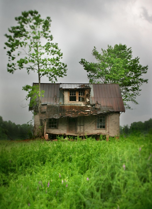 An old house in green field