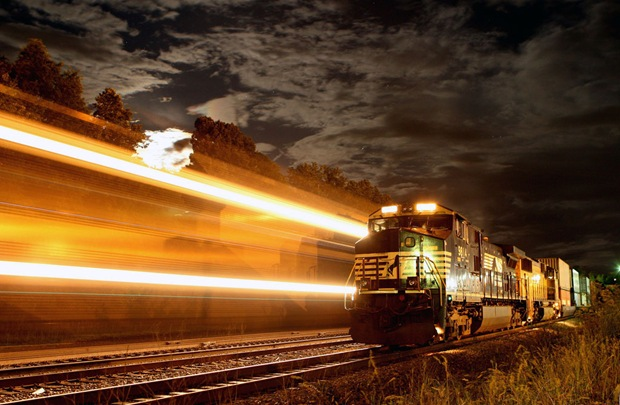 Train crosses Kemper Street, Lynchburg, Virginia, USA during a nearly full moon.