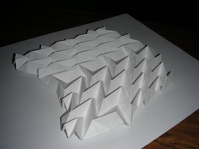 Collapsed compound v-shaped origami accordion