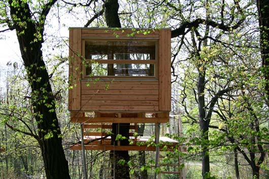 wooden treehouse design with dormer windows