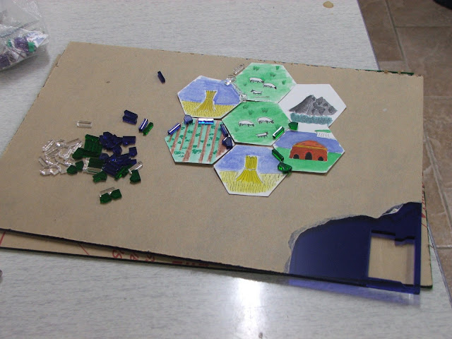 handmade settlers tiles with lazzored pieces