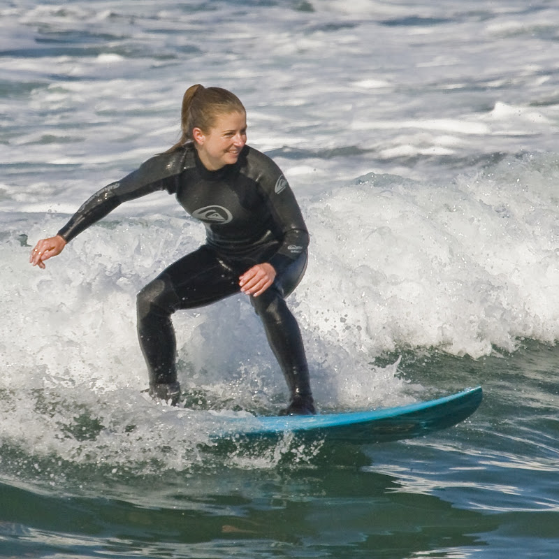 Female surfer at Morro Bay. CA's Morro Rock.jpg