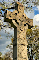 A Celtic Cross at a tombstone