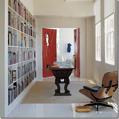 elle decor bookcase in hallway