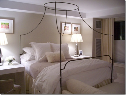 surroundings blog white bedding with iron canopy bed