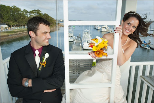 yellow and red wedding bouquet Photography by Geoff L Johnson