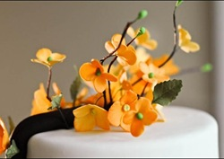 orange flowering branch wedding cake