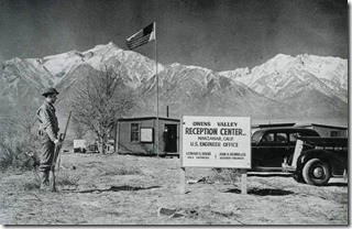 Military police gaurding the entrance to Manzanar