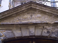 Date: December 2007</p> <p>Location: Paris</p> <p>Story: You get two pictures today, the first is the door, the second the inscription above the door. The hotel is long gone. There is a plaque in the wall beside this door that refers you to http://cribier.net/Hotel-Raoul/ for more information on the door. The article is in French.</p> <p>It is not clear why the door has been almost preserved. It seems to have survived in spite of the neglect imposed upon it. A magnificent door it is. The buildings it hides date from the 1500's to the 1800's. I am also not sure why it is called an hotel, since it appears to have never fulfilled that role.