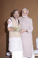 Shri Sudarshan Iyengar Felicitates Shri Vipoolbhai Kalyani