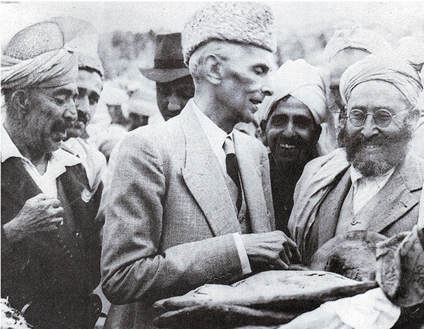 [Quaid-e-Azam accepting a loaf of bread from tribesmen in Khyber Agency[5].png]