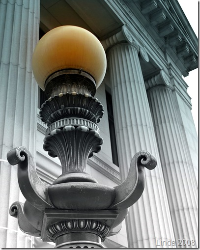 A lamp in front of the Chelsea Savings Bank in downtown Norwich, CT