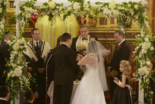 In some wedding ceremonies the bride and groom will be wrapped in a tallit