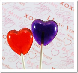 red and purple heart-shaped lollipops in front of valentine words