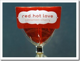 cinnamon-cherry lollipop in a red wrapper