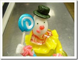 sugar sculpture of a clown holding a lollipop